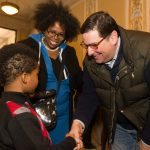 Mayor Bill Peduto shakes hands with a young guest at East Liberty Celebrates MLK